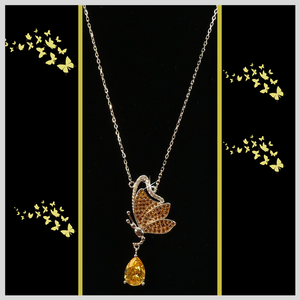 Gemstone citrine yellow created with pave butterfly necklace.