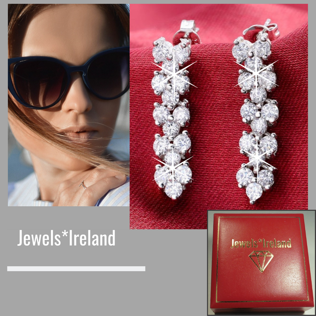 Elegant earrings with a fusion of man made diamond earrings.