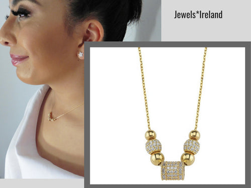 Gold charm barrel design necklace with pave stones
