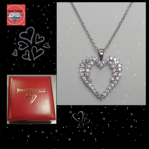 Statement heart shape diamond simulant necklace.