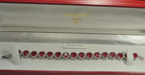 Dazzling circular red stone bracelet with lab created diamonds