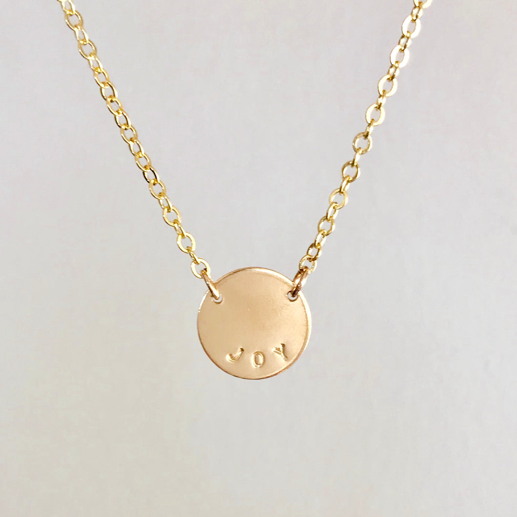 Custom Mini Gold Disc Necklace. Made by Erin Bess Jewelry. Personalize this dainty gold disc necklace with a name, word or monogram. This delicate gold disk necklace will be the one you reach for every morning. Made of 14K gold, this tiny gold coin necklace will be beautiful for years to come.