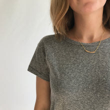 Load image into Gallery viewer, Dainty Gold Hammered Bar Necklace. This delicate curved hammered bar necklace is hand-crafted by Erin Bess in Indiana. The dainty gold necklace necklace will quickly be the one you reach for everyday. The simple hammered bar necklace adds the perfect amount of sparkle to everyday outfits.