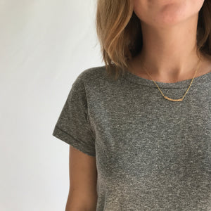 Dainty Gold Hammered Bar Necklace. This delicate curved hammered bar necklace is hand-crafted by Erin Bess in Indiana. The dainty gold necklace necklace will quickly be the one you reach for everyday. The simple hammered bar necklace adds the perfect amount of sparkle to everyday outfits.