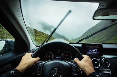 driving through the rain with phone mounted on dashboard