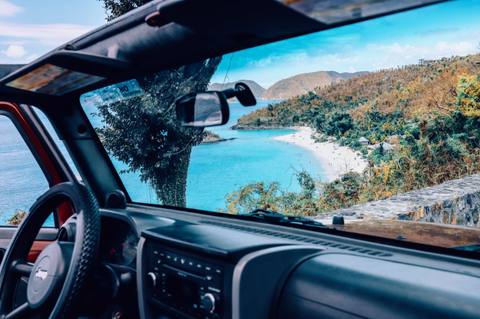 windshield showing the beach nearby