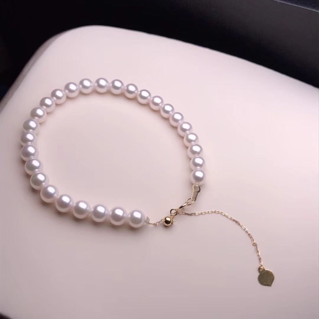 5.5-6.0 mm AAA White Akoya Pearl Bracelet with 18K Yellow Gold Clasp - takaramonobr