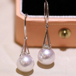 Load image into Gallery viewer, Tower Collection 10.0-11.0 mm White South Sea Pearl & Diamond Dangle Earrings Mounted on G18k - takaramonobr