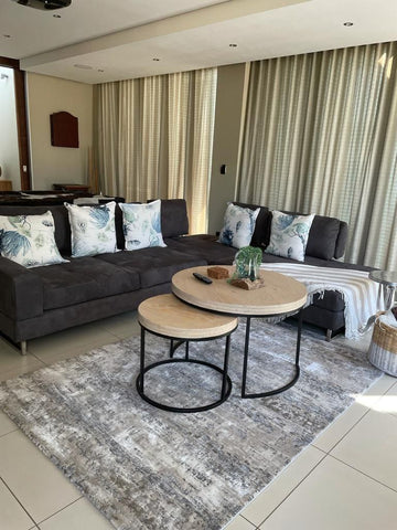 Nesting coffee table in living room.