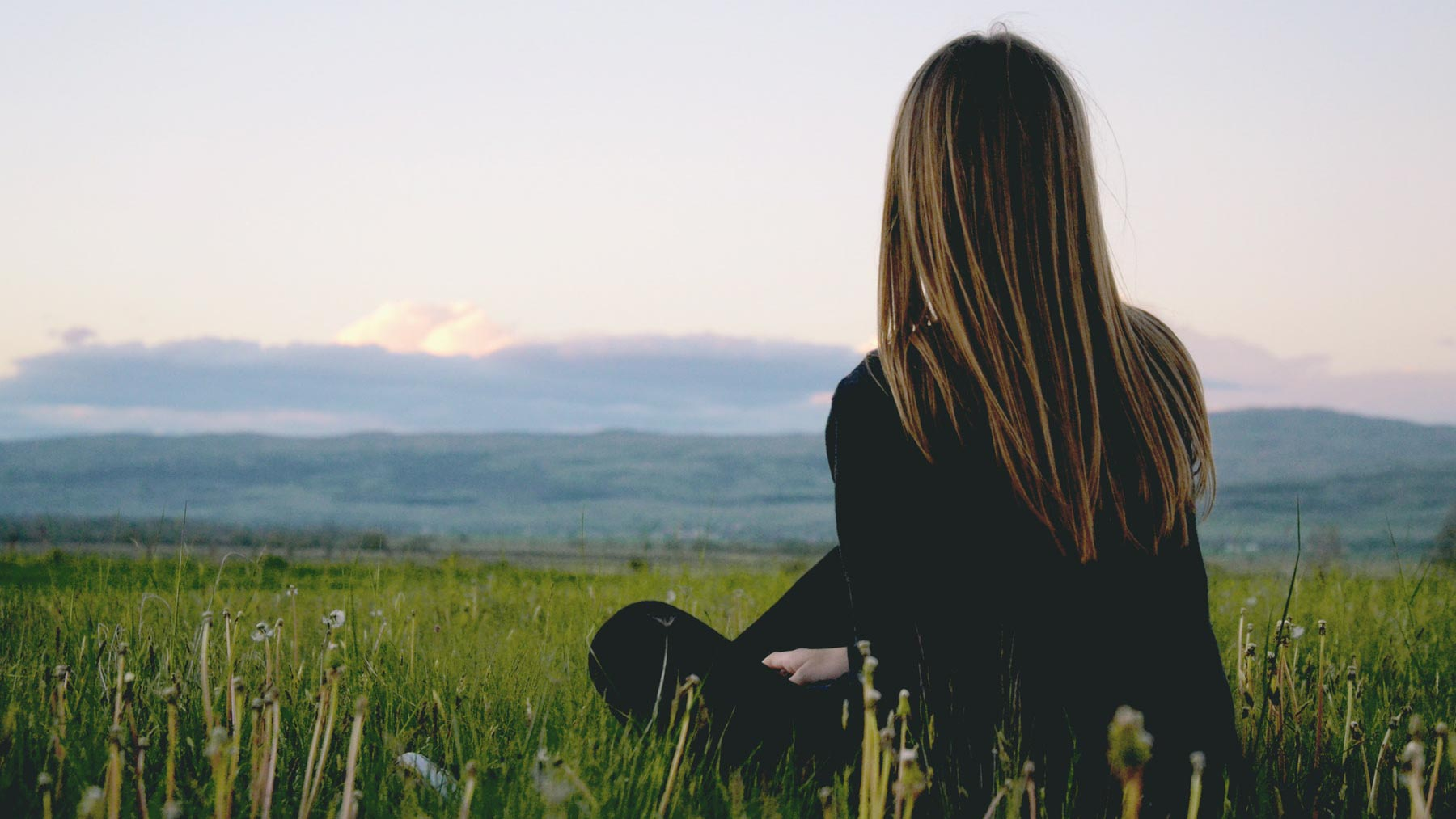 woman contemplating scenery to clear mind