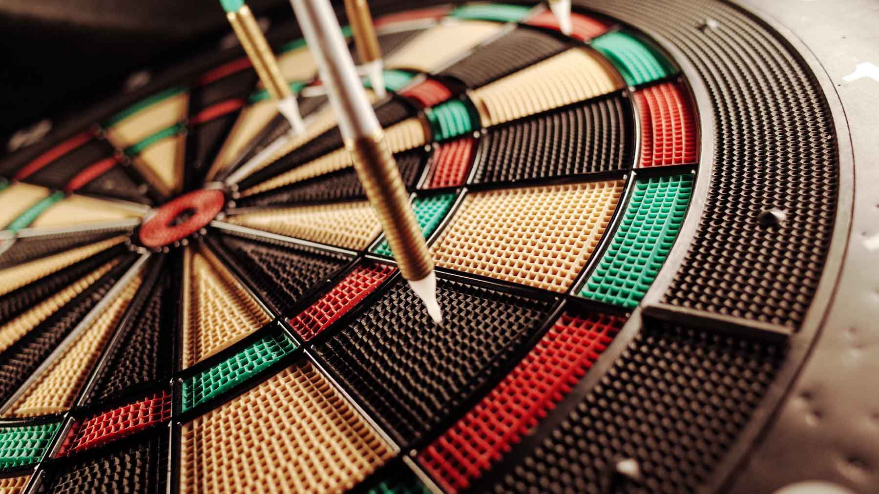 darts targeting dartboard