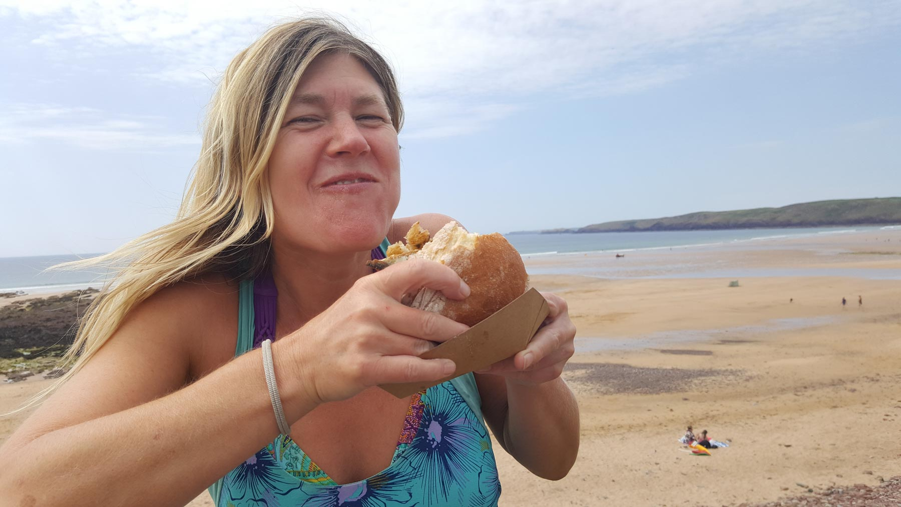 eating mackerel butty on the beach