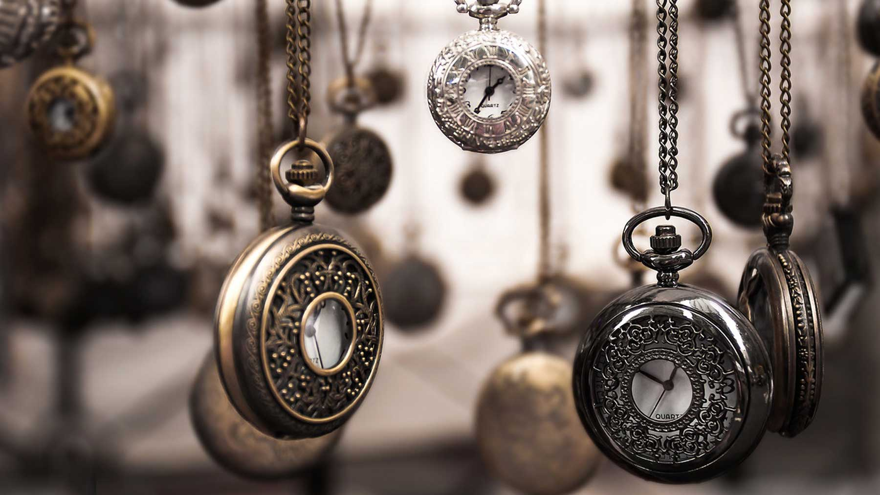 old-fashioned watches on chains hanging down to signify time