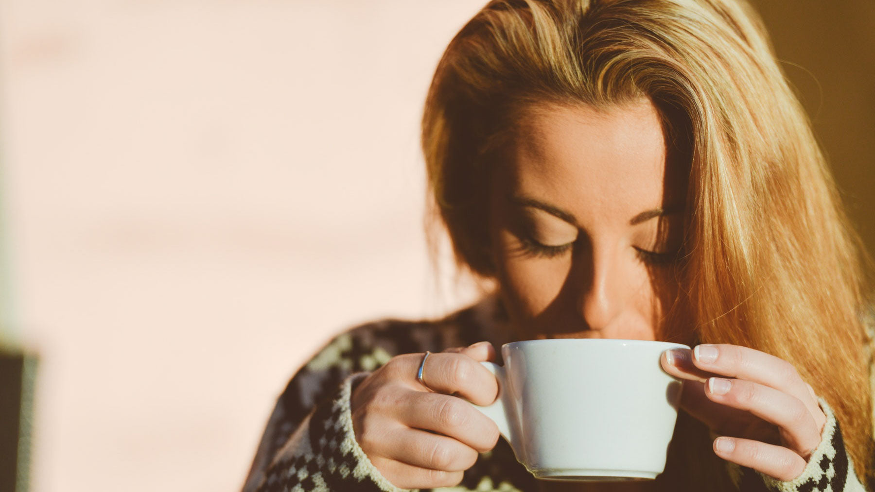 unworried woman drinking cup of tea