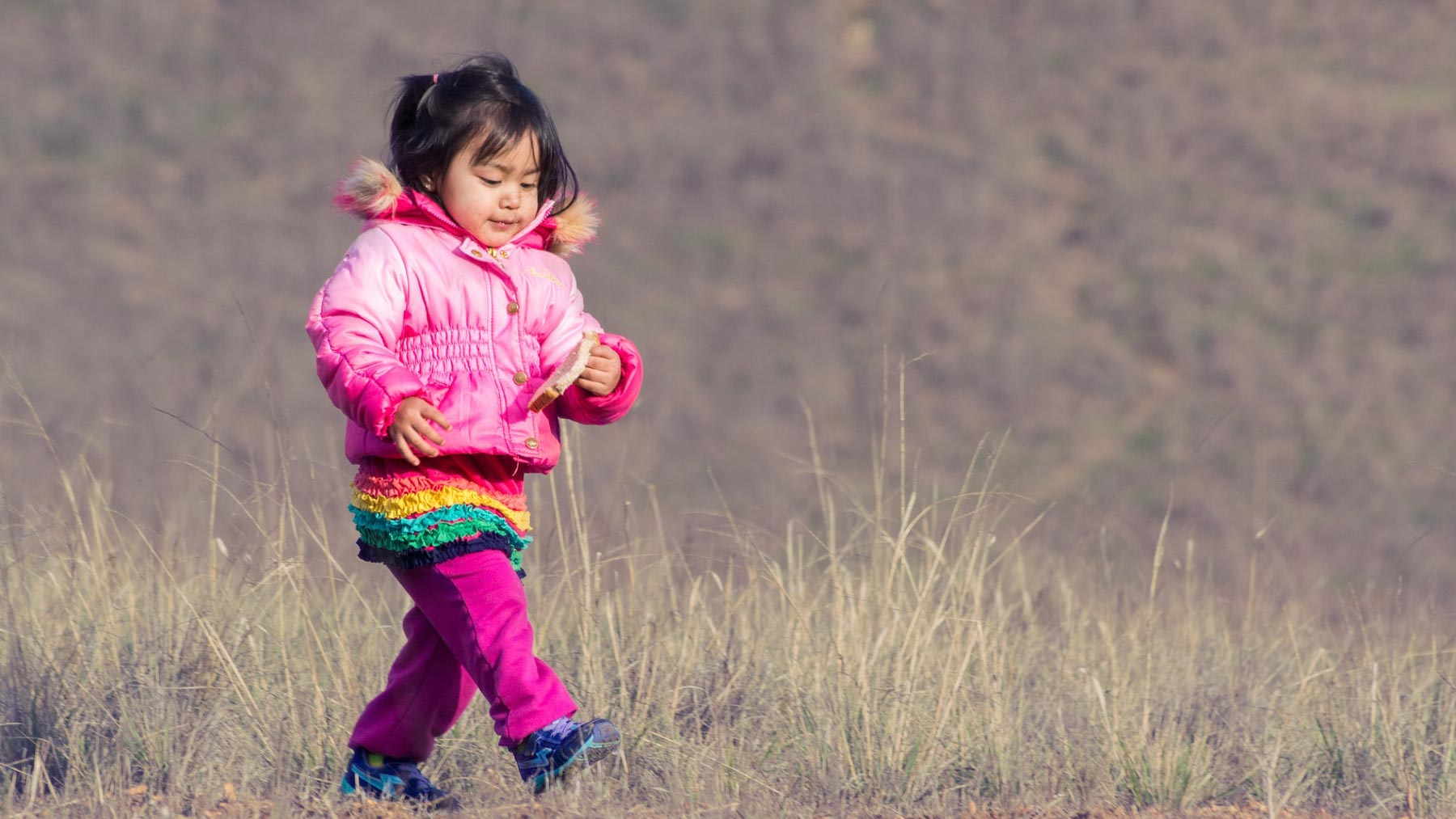 little girl walking to represent taking one step at a time