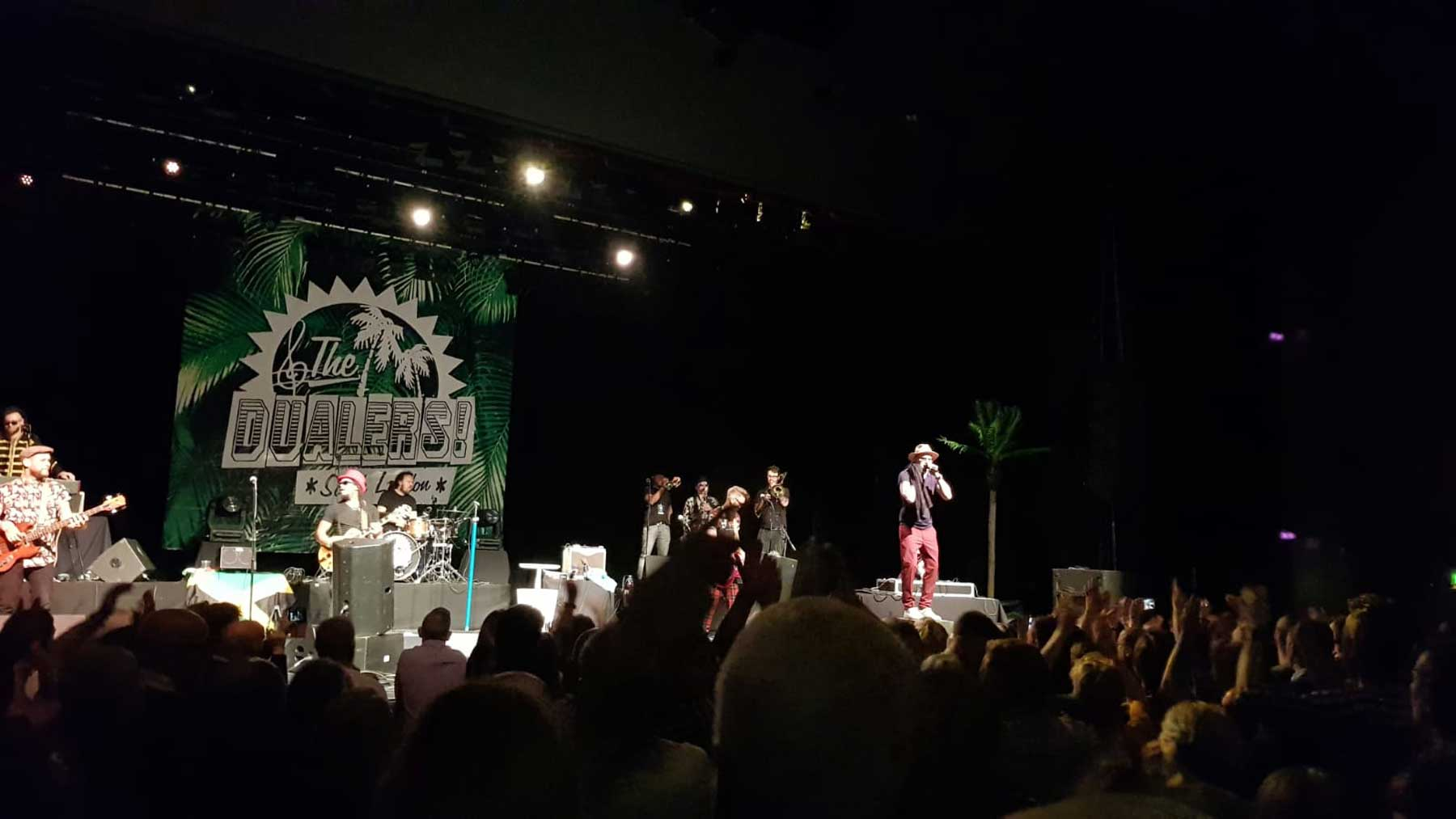 ska band on stage with crowd dancing on a saturday night