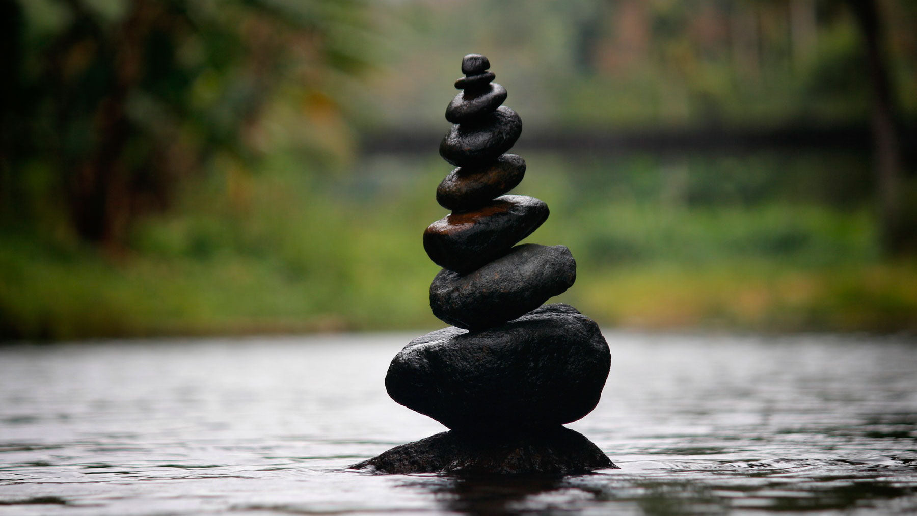 stack of stones balancing on top of one another to represent a peaceful life without alcohol