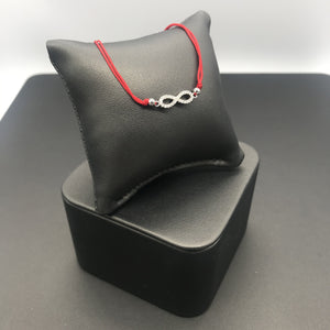 Sterling Silver Infinity Bracelet on Red Cord