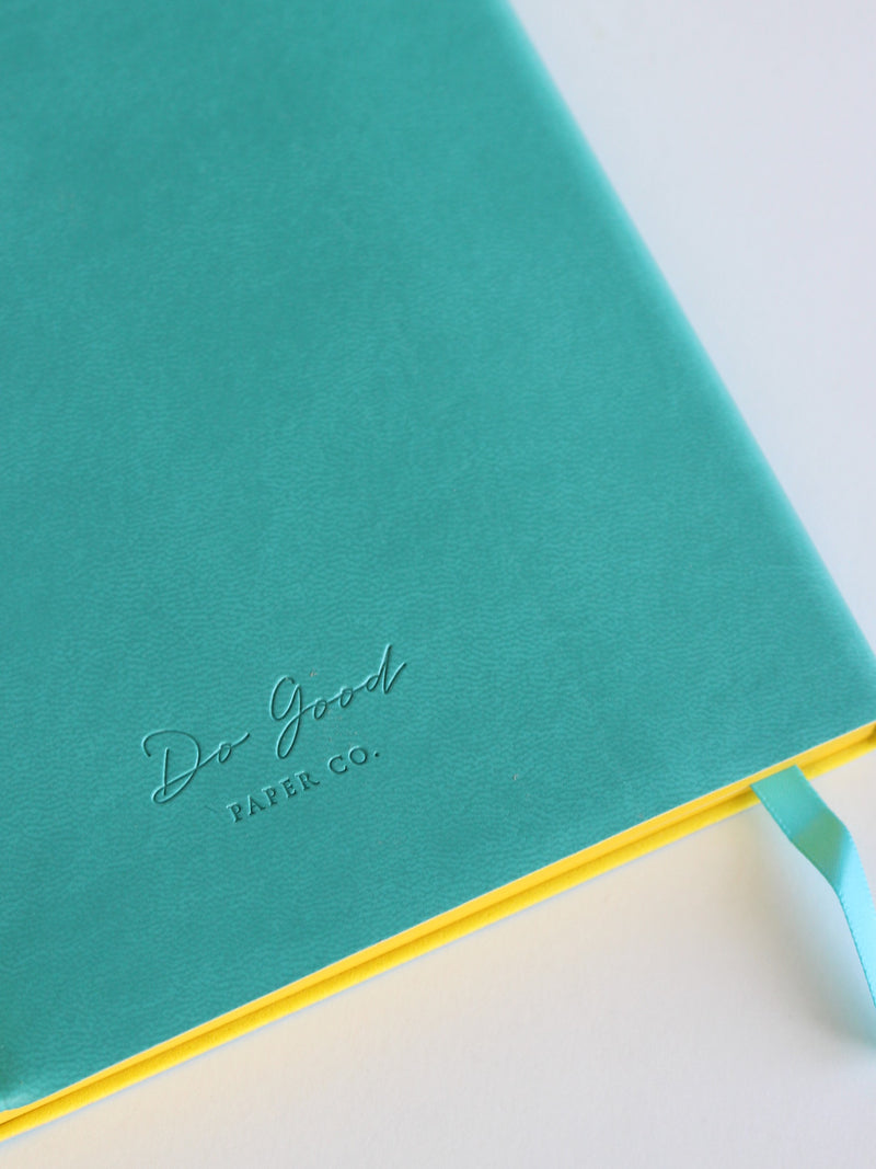 Bullet journal - turquoise with yellow, back cover with Do Good Paper Co. logo