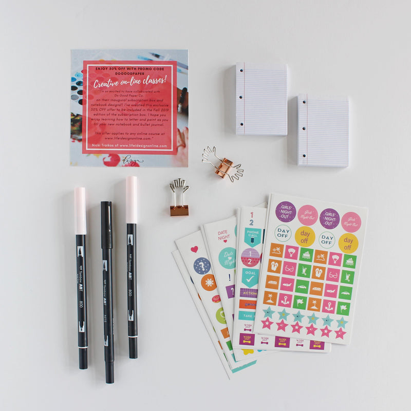 Tombow brush pens, stickers, binder clips, sticky notes and coupon for online course to learn brush lettering