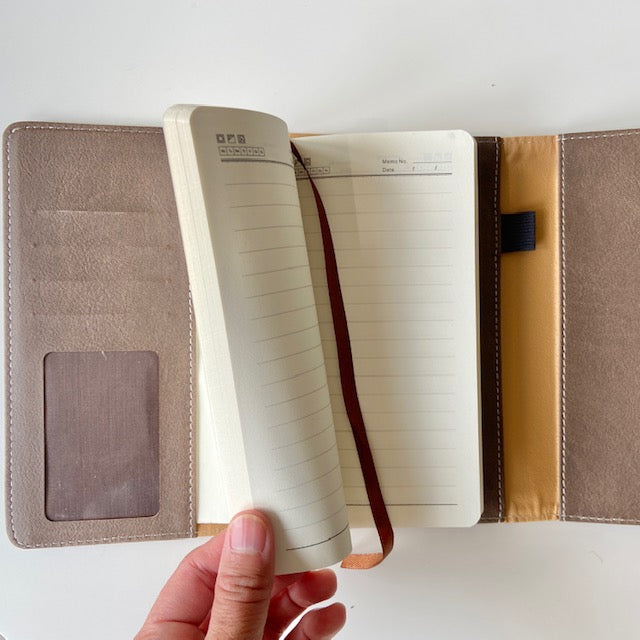 Personal Folio in brown, with card slots, pockets, pen loop and small notebook for on the go notes