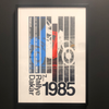 1985 Rallye Dakar Poster. 7th year. Depicting a Dakar motorcycle and rider in bmw colours blue, white, and red