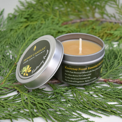 Forest scented essential oil infused beeswax candle in metal tin for travelling