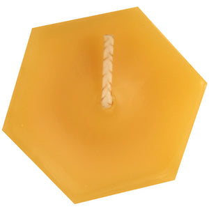 The top of a hexagonal beeswax votive candle and wick, yellow to golden yellow color, with a sweet honey scent.