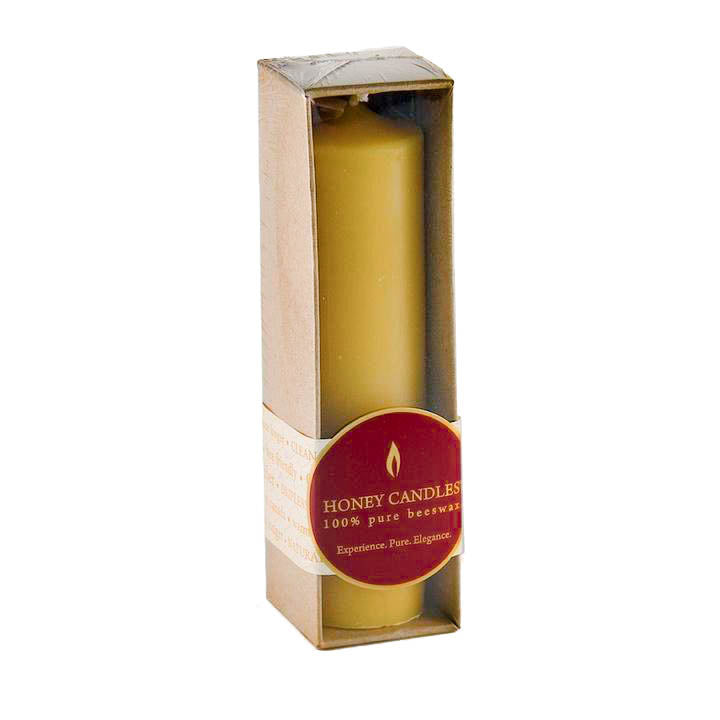 Golden yellow candlestick, packaged in Kraft paper, with Honey Candles Label across the bottom.