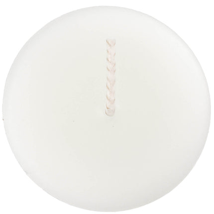 The top of a beeswax votive candle and wick, made from natural capping wax, white to pearl in color.