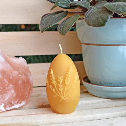 Beeswax egg candle with springtime home decor