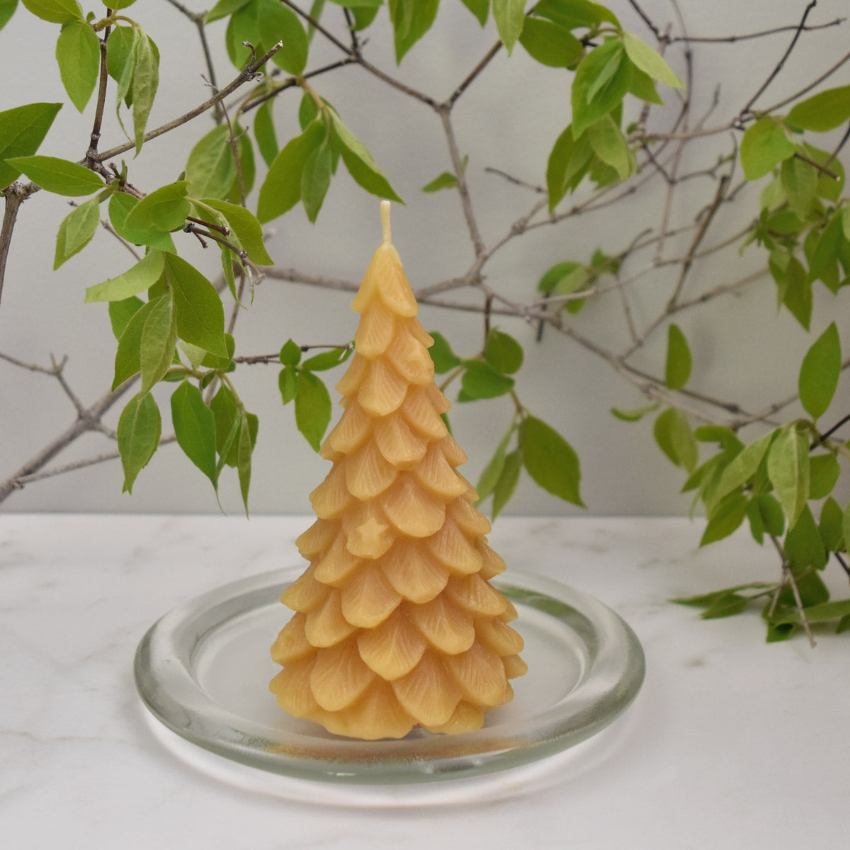 Yellow natural beeswax ornamental christmas tree candle made with 100% pure beeswax
