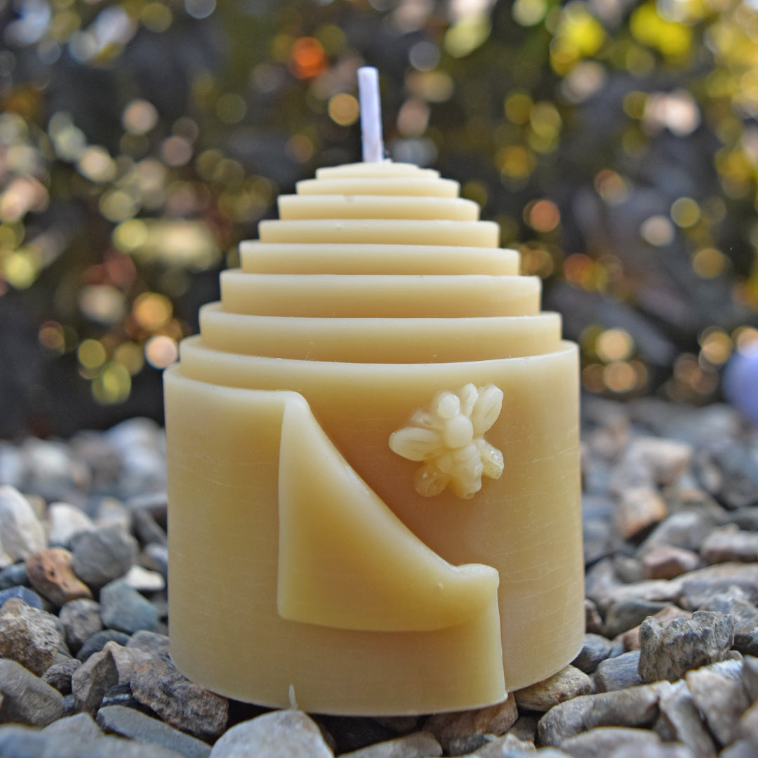 Natural bees wax skep shaped pillar candle with cute bee design