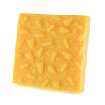 one pound block of natural golden beeswax, with bees on honeycomb.