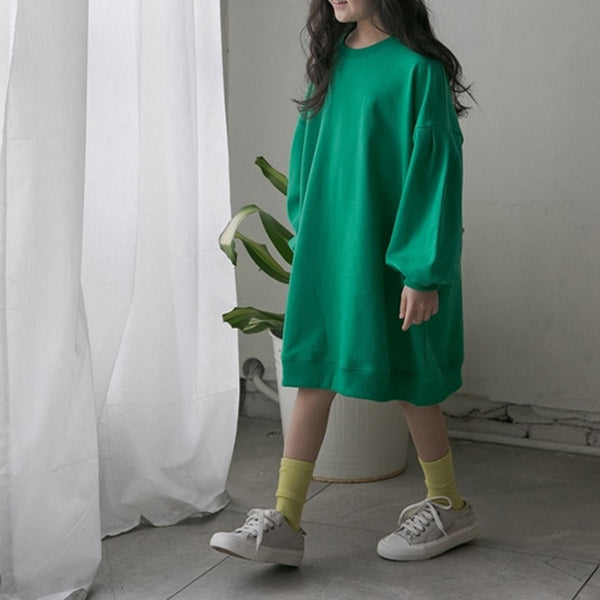 Girls Summer Dress. We love the bold, striking colour and clever detailing on this simple light-weight spring dress. Featuring a round neck, balloon style sleeves that nip in at the cuff and a stretch band at the bottom. Made in fine and light weight sweatshirt cotton.