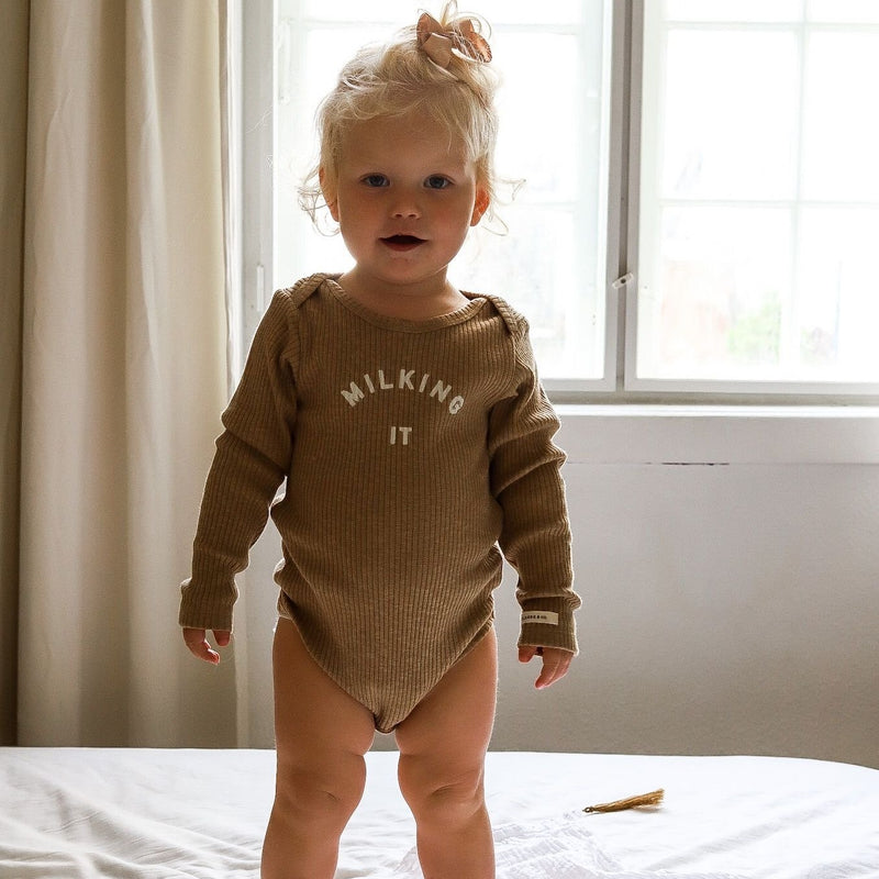 EXCLUSIVE Milking It Rib Romper Long Sleeve Body Suit (Caramel)