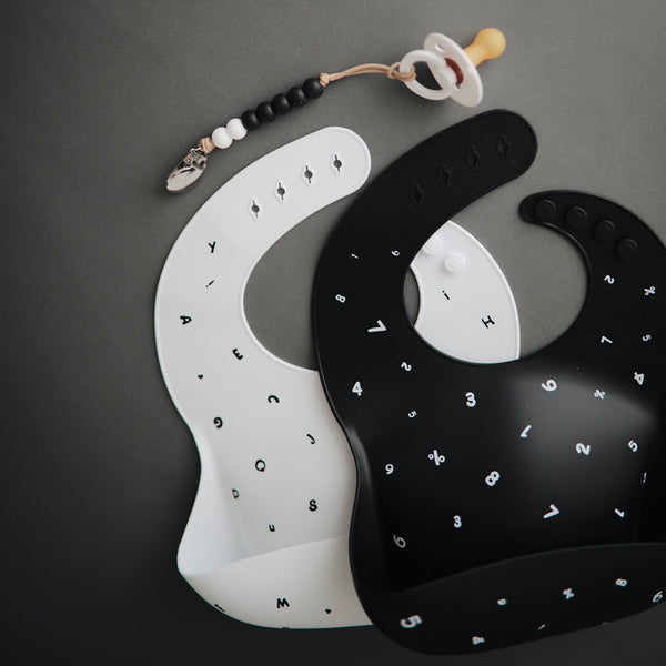 Mushie Silicone Pocket Bib (Black or White)