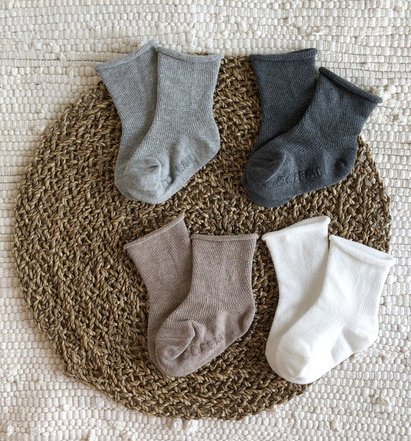 neutral set of socks for kids and baby in white, beige, grey and charcoal