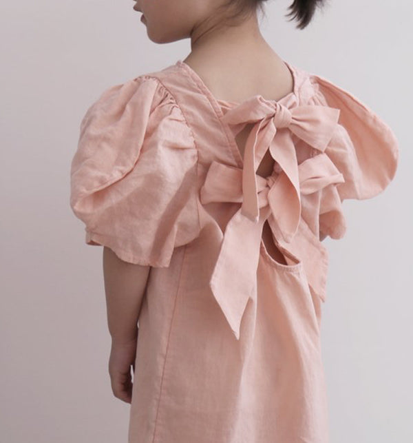 pink peach girls and baby dress with open tie bows at the back. COtton linen