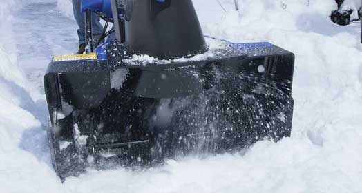 Electric snow blower capable of handling 8-inch-deep snow while weighing just over 35 lbs.