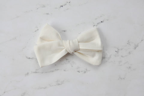 cream hand tied bow