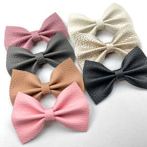 XL textured faux leather bow