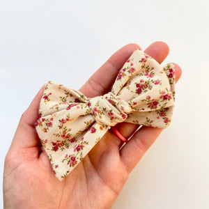 tan floral hand tied bow