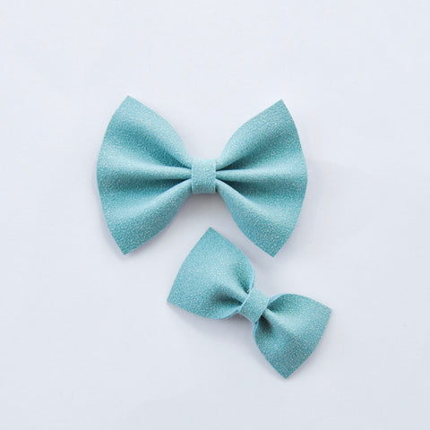topaz faux suede bow