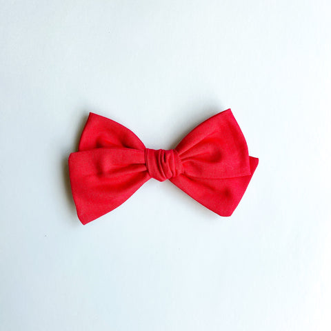 red hand tied bow