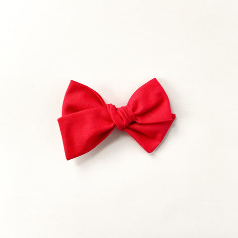 red pinwheel hand tied bow