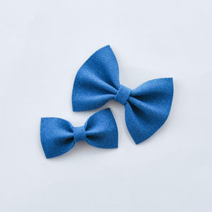 blue faux suede bow