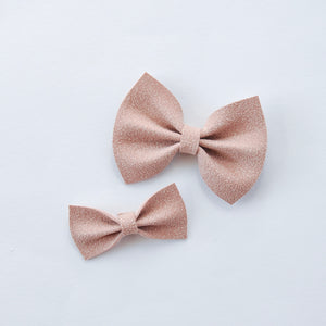 blush faux suede bow