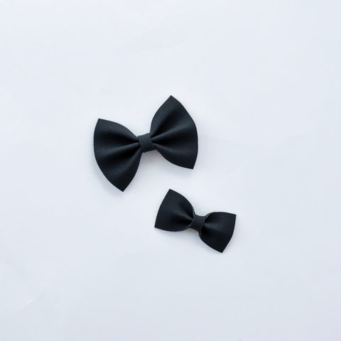 black faux suede bow
