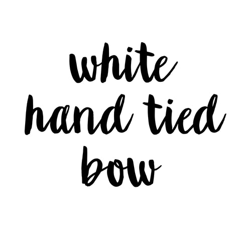 white hand tied bow